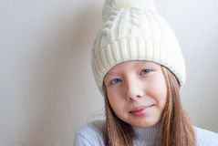 Portrait of young beautiful teen girl in a knitted hat Stock Images