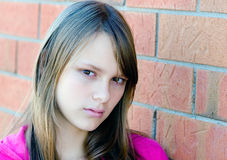 Portrait of a young beautiful teenager girl. With serious thinking expression royalty free stock photo