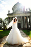 Portrait of young beautiful tender bride lightened with sun back Stock Photo