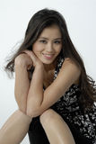 Portrait of a young beautiful woman. Studio portrait of an asian girl sitting Stock Photography