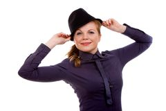 Portrait of a young beautiful woman. Holding her hat Stock Photos
