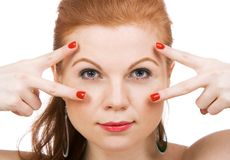 Portrait of a young beautiful woman. With fingers near her eyes Stock Photos