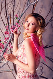 Portrait of young beautiful woman in angel costume with pink win Royalty Free Stock Photos