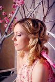 Portrait of young beautiful woman in angel costume with pink win Royalty Free Stock Images
