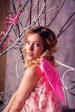 Portrait of young beautiful woman in angel costume with pink win Stock Photos
