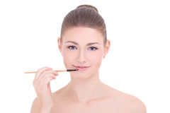 Portrait of young beautiful woman applying lipstick on her lips Stock Photos