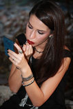 Portrait of a young beautiful woman applying lipstick for lips Royalty Free Stock Photography