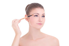 Portrait of young beautiful woman applying make up with brush is Stock Images