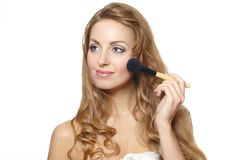 Portrait of young beautiful woman applying makeup Stock Photo