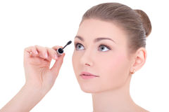 Portrait of young beautiful woman applying mascara on eyelashes Royalty Free Stock Photo