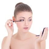 Portrait of young beautiful woman applying mascara on her eyelas Royalty Free Stock Photo