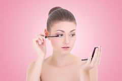 Portrait of young beautiful woman applying mascara on her eyelas Royalty Free Stock Photography