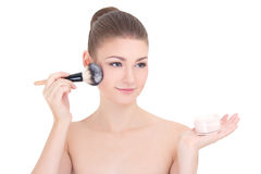 Portrait of young beautiful woman applying powder with make up b Stock Image
