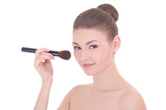 Portrait of young beautiful woman applying rouge or powder with Stock Photos