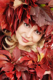 Portrait of the young beautiful woman with autumn Royalty Free Stock Image