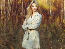 Portrait of young beautiful woman in autumn cloak Stock Images