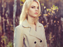 Portrait of young beautiful woman in autumn cloak Royalty Free Stock Images