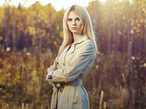 Portrait of young beautiful woman in autumn cloak Royalty Free Stock Photo