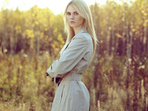 Portrait of young beautiful woman in autumn cloak Royalty Free Stock Photos
