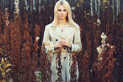 Portrait of young beautiful woman in autumn cloak Royalty Free Stock Photography