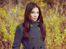 Portrait of young beautiful woman in autumn coat Royalty Free Stock Photography