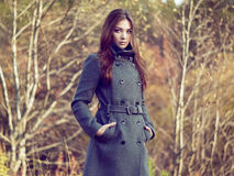 Portrait of young beautiful woman in autumn coat Stock Images