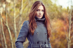 Portrait of young beautiful woman in autumn coat. Fashion photo Stock Photography