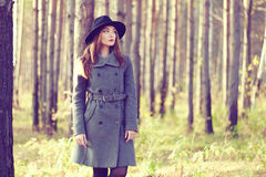 Portrait of young beautiful woman in autumn coat. Fashion photo Royalty Free Stock Images