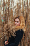 Portrait of young beautiful woman in autumn coat. Stock Image