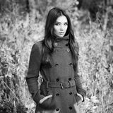Portrait of young beautiful woman in autumn coat. Fashion photo. Black and white Royalty Free Stock Photography