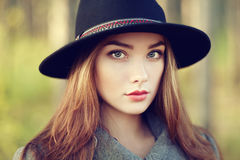 Portrait of young beautiful woman in autumn coat. Girl in hat. Fashion photo Royalty Free Stock Images