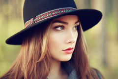 Portrait of young beautiful woman in autumn coat. Girl in hat. Fashion photo Stock Image