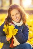Portrait of young beautiful woman in autumn park. Young beautiful woman in autumn park Royalty Free Stock Image