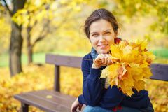 Portrait of young beautiful woman in autumn park. Young beautiful woman in autumn park Royalty Free Stock Images