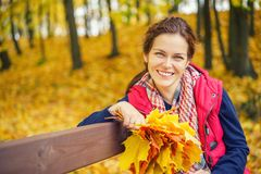 Portrait of young beautiful woman in autumn park. Young beautiful woman in autumn park Stock Photos