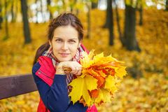 Portrait of young beautiful woman in autumn park. Young beautiful woman in autumn park Stock Photo
