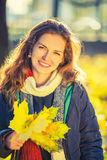 Portrait of young beautiful woman in autumn park Royalty Free Stock Photography