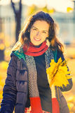 Portrait of young beautiful woman in autumn park Royalty Free Stock Images