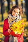 Portrait of young beautiful woman in autumn park Stock Photo