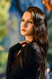 Portrait of young beautiful woman in autumn park. Beauty. Fashion photo stock image