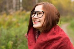 Portrait of a young beautiful woman in an autumn park. Slow motion Stock Image