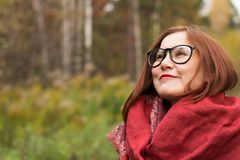 Portrait of a young beautiful woman in an autumn park. Slow motion Royalty Free Stock Photography