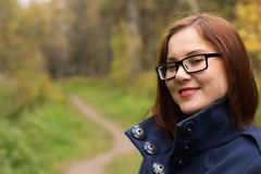 Portrait of a young beautiful woman in an autumn park. Slow motion Stock Photography
