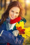 Portrait of young beautiful woman in autumn park Stock Image