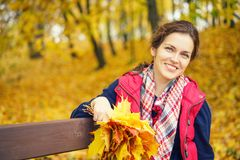 Portrait of young beautiful woman in autumn park. Young beautiful woman in autumn park Royalty Free Stock Photography