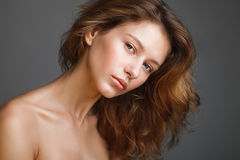 Portrait of young beautiful woman with bare shoulders and fresh stock photography