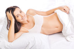 Portrait of young beautiful woman in bed Royalty Free Stock Photography