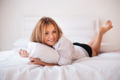 Portrait of young beautiful woman on bed Stock Photography