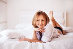 Portrait of young beautiful woman on bed Stock Photo