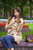 Portrait of a young beautiful woman in beige coat Stock Images
